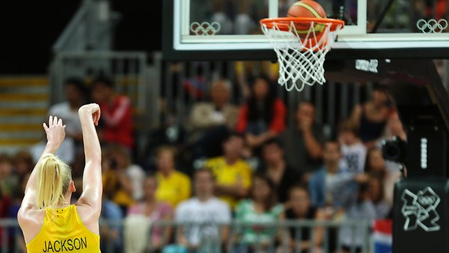 As the ball drops through the rim, Australia's Lauren Jackson breaks USA's Lisa Leslie's record to become the highest scorer in women's Olympic basketball history during a game against Brazil.