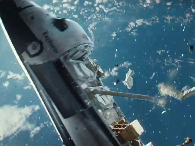 Debris hammer a space shuttle into oblivion in the movie Gravity. Once seen as a frontier of peace, space is now turning into a war zone. Picture: Gravity / Warner Brothers