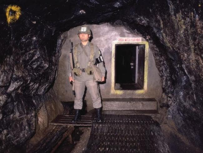 A soldier is pictured standing guard outside the entrance to one of the tunnels. Picture: Getty Images