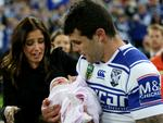 Bulldog's Michael Ennis walks out with his kids for his last home game for the Canterbury Bankstown Bulldogs at ANZ Stadium. Picture Gregg Porteous