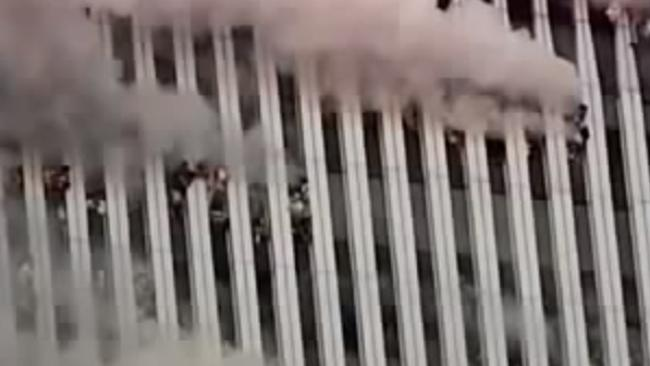 Workers trapped inside the Twin Towers hang out of windows gasping for air. (Pic: YouTube)