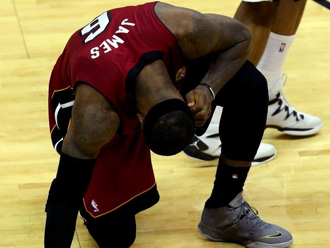 LeBron James #6 of the Miami Heat suffers a cramp.