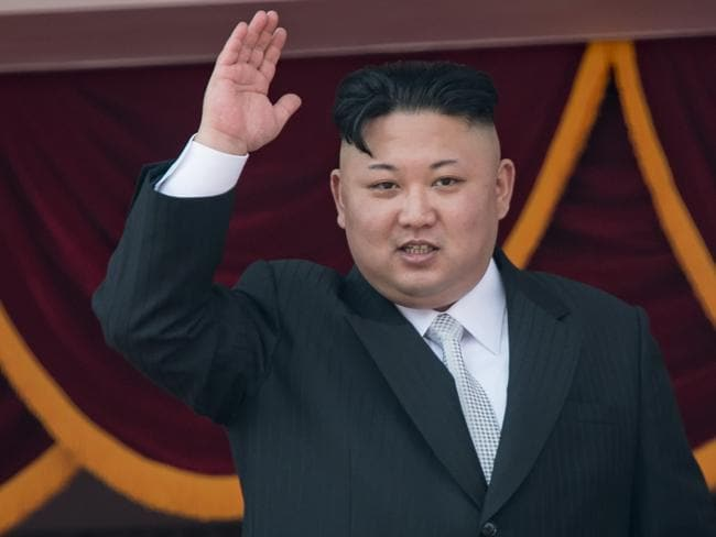 North Korean leader Kim Jong-Un waves from a balcony of the Grand People's Study house following the military parade. Picture: AFP.