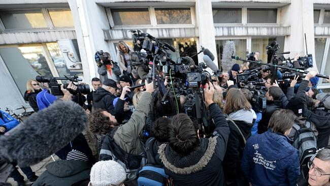 A mass of journalists stand outside the hospital waiting for news about Schumacher's condition.