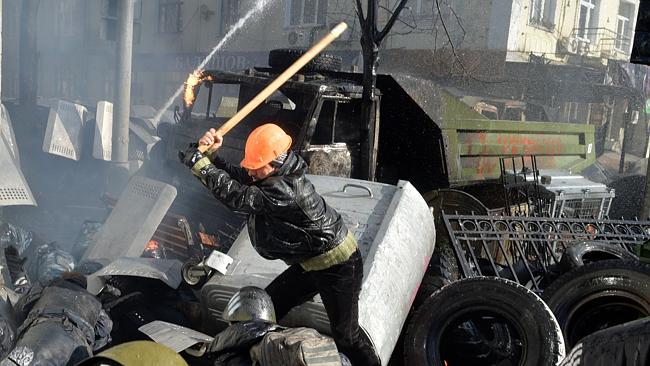 Violence flares up...Anti-government protesters clash with police in front of the Ukrainian Parliment in Kiev.