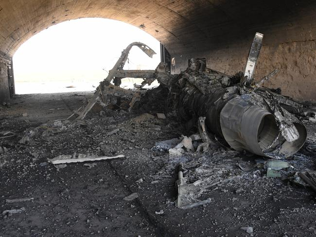 The body of a plane burned as a result of the US missile attack on an air base in Syria. Picture: AFP
