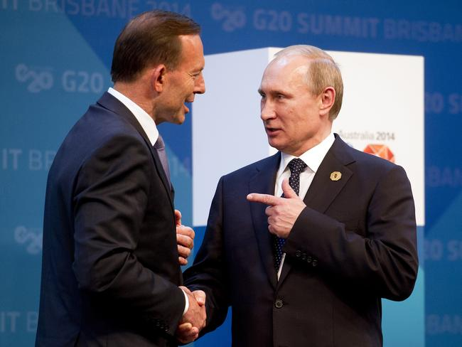 No love lost ... Vladimir Putin, right, is greeted by Tony Abbott. Picture: AP