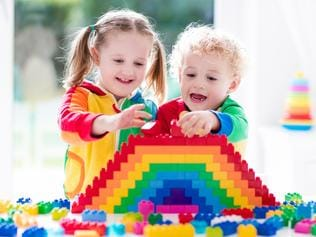 Children playing with colorful blocks