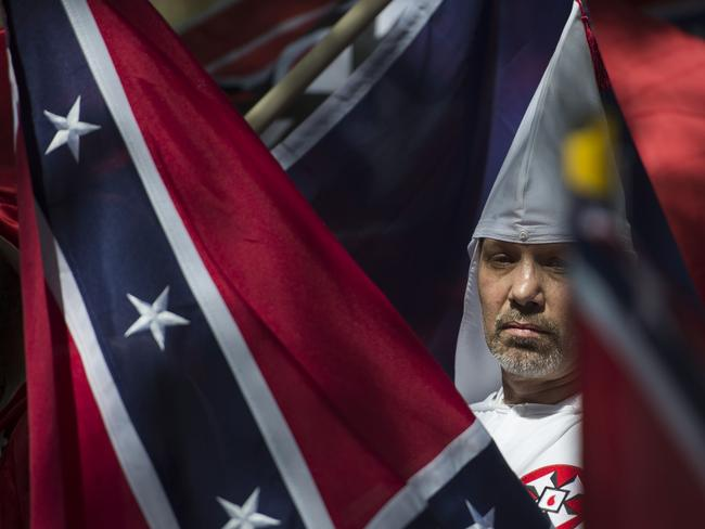 A member of the Ku Klux Klan calls for the protection of Southern Confederate monuments, in Charlottesville, Virginia. Picture: Andrew Caballero-Reynolds/AFP