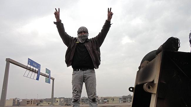 A man believed to be a militant shows off the V-sign for victory near Fallujah. Picture: AFP