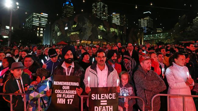 Melburnians gather for a candlelight vigil for AIDS 2014 and victims of MH17 at Federation Sqaure. Picture: Mark Stewart