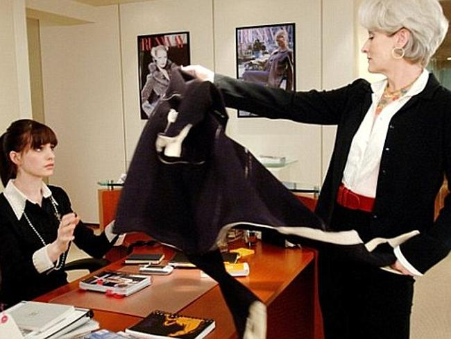 Devil Wears Prada Imperious fashion magazine editor Miranda Priestly (Meryl Streep) dumps her coat on the desk of new assistant Andy Sachs (Anne Hathaway).
