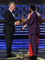 Donald Glover accepts Outstanding Lead Actor in a Comedy Series for 'Atlanta' from actor Alec Baldwin onstage during the 69th Annual Primetime Emmy Awards at Microsoft Theater on September 17, 2017 in Los Angeles, California. Picture: Getty