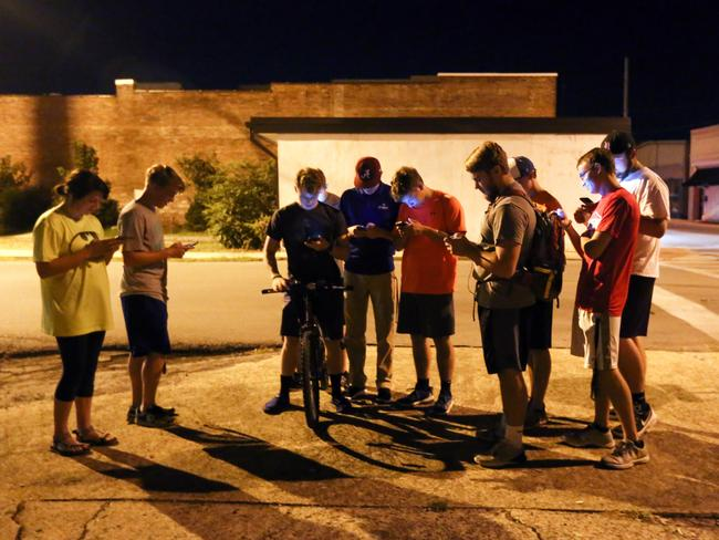 "A group of teenagers play ""Pokemon Go"" in downtown Hartselle, Ala., on Wednesday, July 13, 2016. (Crystal VanderWeit/The Decatur Daily via AP)"