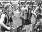 Andy Collins(?) and Gary Ayres with premiership cup. 1988 Grand Final. Hawthorn v Melbourne. MCG. Neg: 880924/141