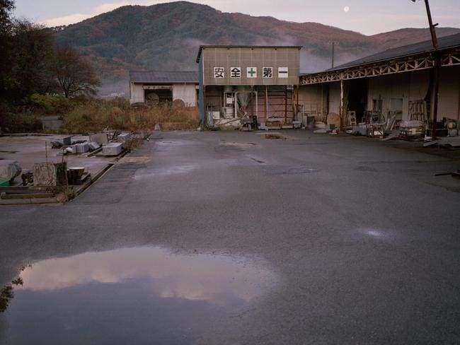 A depot at Tsushima, a village in Namie district, close to the exclusion zone sits empty in this picture from Shadowlands, Robert Knoths 2011 documentary series.