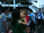 Heartbroken and desperate, survivors of Typhoon Haiyan wait to board a C130 aircraft during the evacuation.