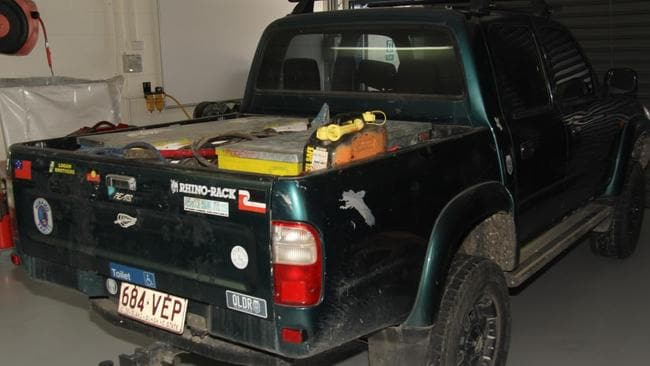 The Hilux has several stickers on the back of the tray.