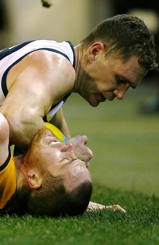 Joel Selwood tangles with Jarryd Roughead in the second term. Picture: Wayne Ludbey.