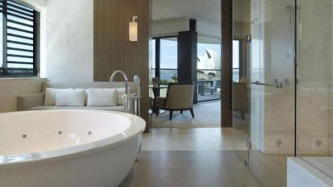 The Sydney Suite bathroom features a deep, jetted tub, a sauna and a walk-in shower room. Picture: Park Hyatt