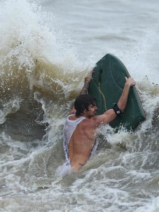 The Premier has slammed 'appalling' behaviour of those surfing and driving in the storm. Picture: Airlie Beach. Photographer: Liam Kidston