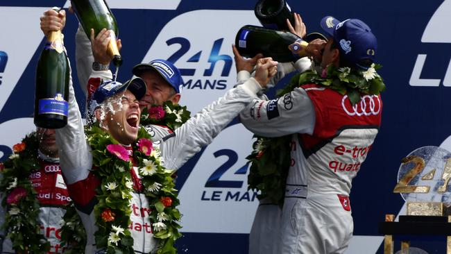 Lotterer and teammates celebrate this year's Le Mans win.