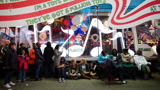 Shoppers wait in line for the 8 p.m. opening of the Times Square Toys-R-Us store in the lead-up to Black Friday, November 22, 2012, in New York. Picture: AP