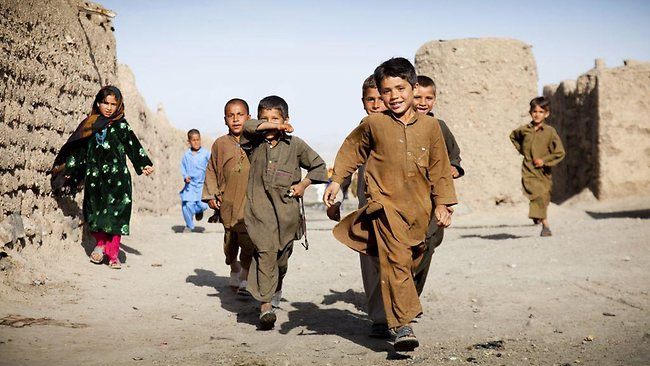 Kids walk to school in the village of Malakh, Afghanista. Picture: World Vision