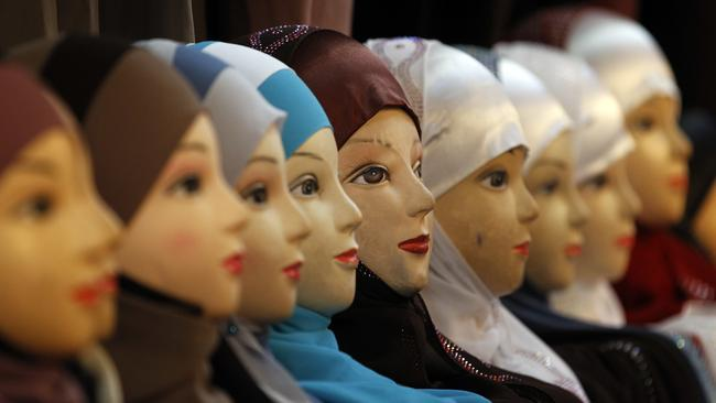 Mannequins with headscarves on display in Paris. Private businesses in Europe can forbid Muslim women in their employ from wearing headscarves. Picture: AP