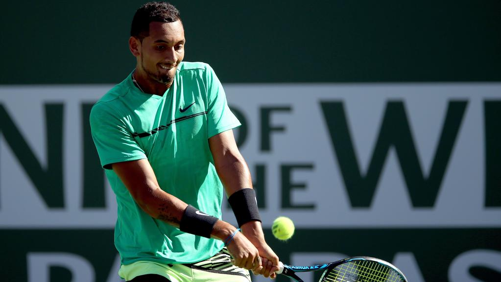 INDIAN WELLS, CA — MARCH 15: Nick Kyrgios of Australia returns a shot to Novak Djokovic of Serbia during the BNP Paribas Open at the Indian Wells Tennis Garden on March 15, 2017 in Indian Wells, California. Matthew Stockman/Getty Images/AFP == FOR NEWSPAPERS, INTERNET, TELCOS & TELEVISION USE ONLY ==