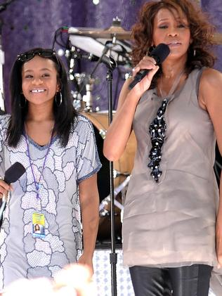 Gone too soon ... Whitney Houston, right, sings with her daughter Bobbi Kristina Brown in 2009. Picture: AP