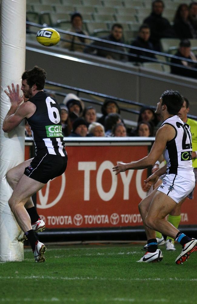 Port Adelaide's Chad Wingard pushes Collingwood's Tyson Goldsack into the post. Pic: George Salpigtidis