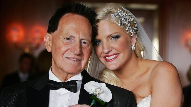 Bride Brynne Gordon and groom Geoffrey Edelsten pose for a photograph after their 2009 wedding