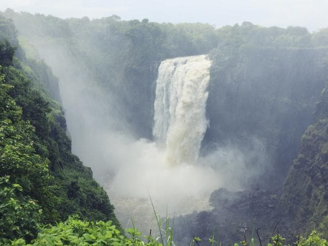 Victoria Falls on the Zambezi River, at the border of Zambia and Zimbabwe, is a major tourist attraction.