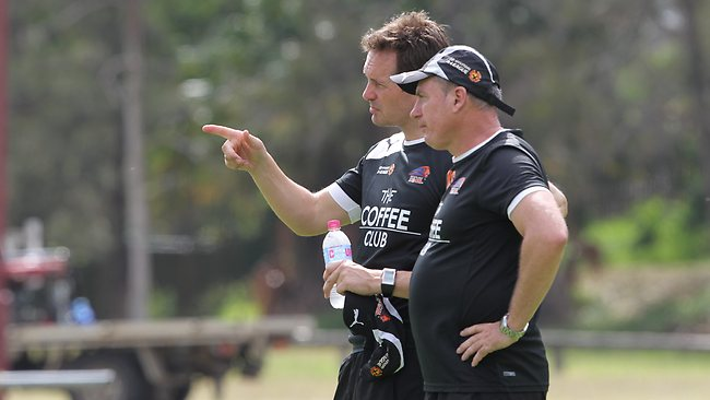 New Brisbane Roar coach Mike Mulvey runs his eye over training with conditioning coach Ken Stead. Picture: Adam Armstrong