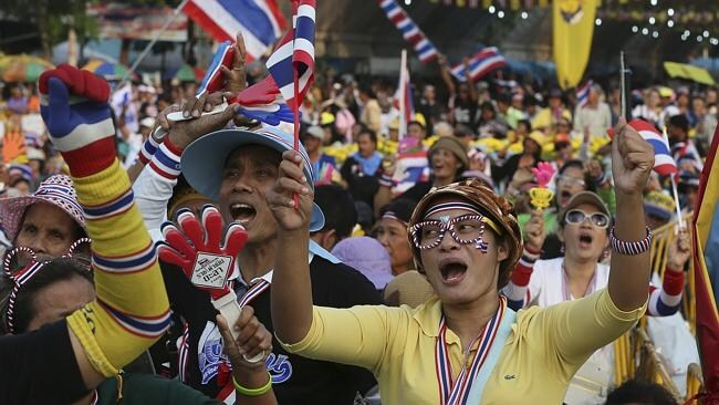 Anti-government protesters shout slogans at the Democracy Monument in Bangkok as the political crisis worsens.