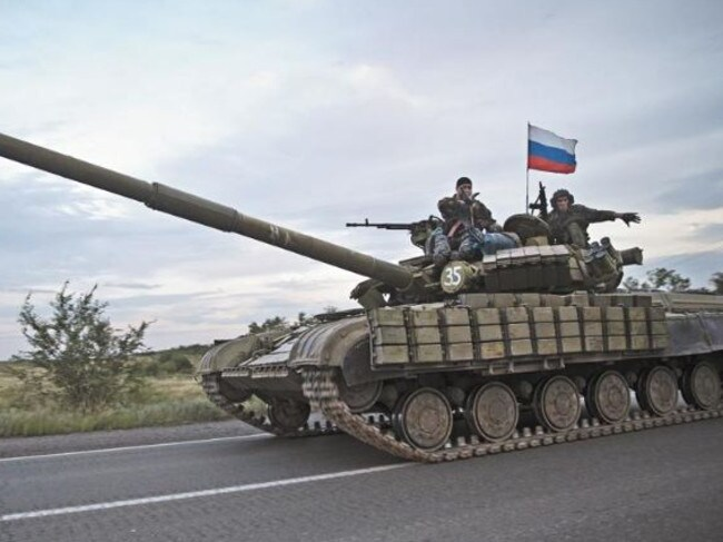 A tank carrying a Russian flag on the road from Donetsk to the Russian border threatens Daily Telegraph correspondent Charles Miranda and his photographer Ella Pellegrini / Picture: Ella Pellegrini