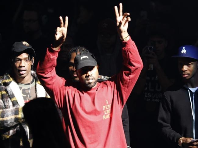 Kanye West gestures to the audience at the unveiling of the Yeezy collection and The Life of Pablo album release. Picture: AP
