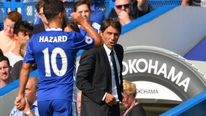 Chelsea's Italian head coach Antonio Conte (R) speaks with Chelsea's Belgian midfielder Eden Hazard during the English Premier League football match between Chelsea and Burnley at Stamford Bridge in London on August 27, 2016. / AFP PHOTO / GLYN KIRK / RESTRICTED TO EDITORIAL USE. No use with unauthorized audio, video, data, fixture lists, club/league logos or 'live' services. Online in-match use limited to 75 images, no video emulation. No use in betting, games or single club/league/player publications. /