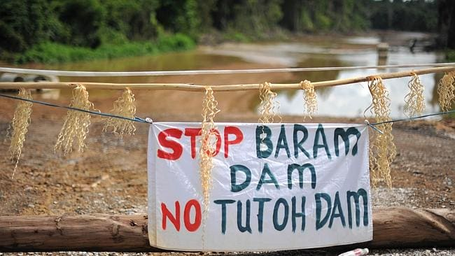 "A banner reading ""Stop Baram Dam"" is hung on the entrance to the first blockade camp of the proposed dam on the Baram River in Long Lama, Borneo. Picture: Mohd Rafsan"