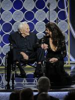 Kirk Douglas and Catherine Zeta Jones speak onstage during the 75th Annual Golden Globe Awards at The Beverly Hilton Hotel on January 7, 2018 in Beverly Hills, California. Picture: Getty