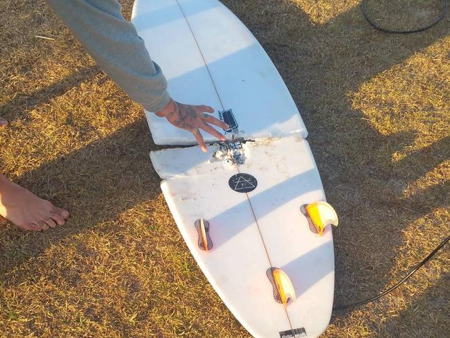 The surfer's board was snapped in half. Picture: Instagram/ brickson_