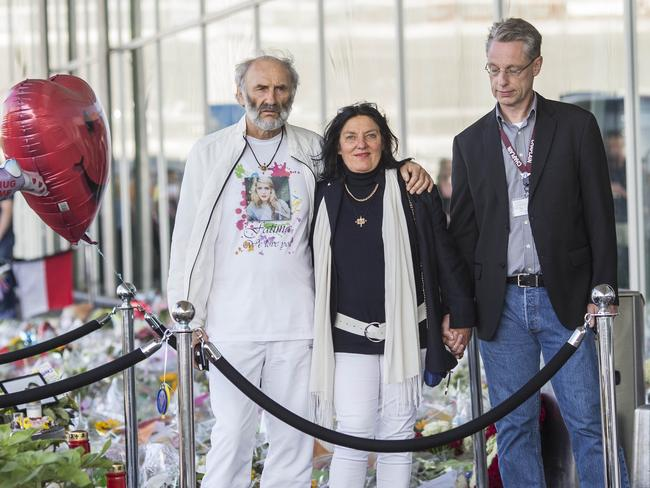 Desperate for closure ... George and Angela Dyczynski, parents of MH17 victim Fatima Dyczynski arrive at Schipohl airport this morning, accompanied by a chaplain.