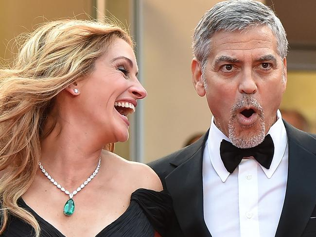 Julia Roberts says she will tease George Clooney about her People magazine title. Picture: AFP