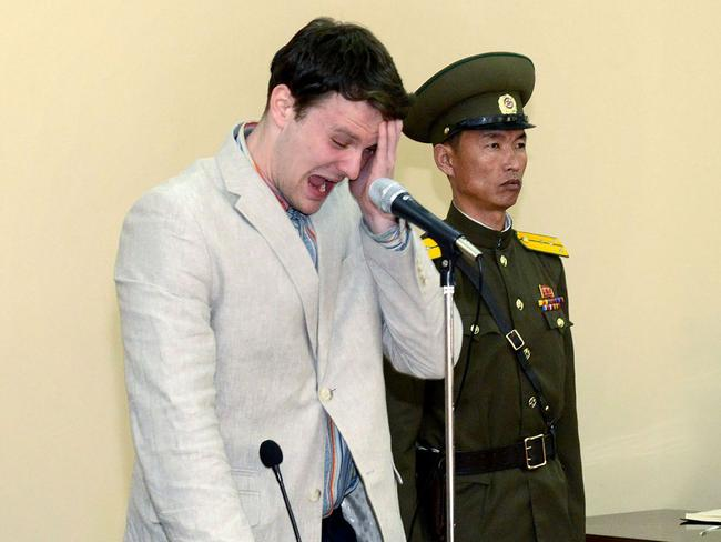 Shock verdict ... US student Otto Frederick Warmbier weeps in court after being sentenced to 15 years hard labour. Picture: AFP/KCNA