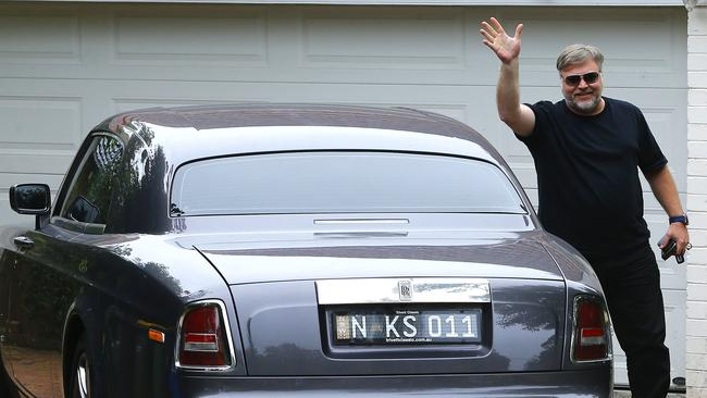 Calm your farm...Kyle Sandilands at his St Ives home with one of his many luxury cars. Picture: Bradley Hunter