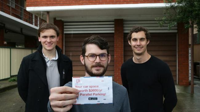 App creators Alex Peck and Jack Perkins with head of technology Peter Carey (centre). Picture: Craig Wilson