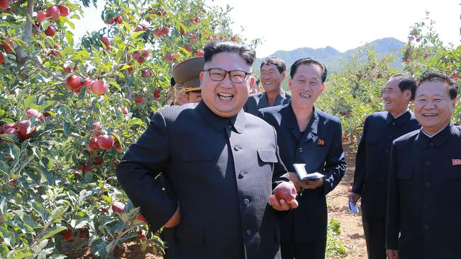 North Korean leader Kim Jong-un gives field guidance during a visit to a fruit orchard in Kwail county. Picture: KCNA via KNS/AFP