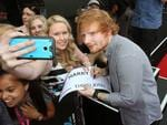 Ed Sheeran pictured with fans on the red carpet at the 2015 ARIA Awards held at The Star in Pyrmont, Sydney. Picture: Richard Dobson