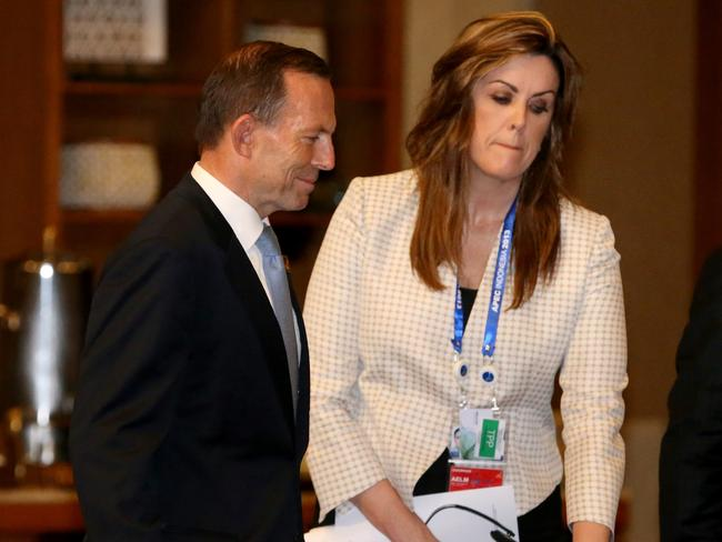 Tony Abbott wishes burqas weren't worn. His chief-of-staff Peta Credlin, right, is sympathetic to a ban at Parliament House.
